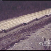 [Aerial view of pipeline construction]